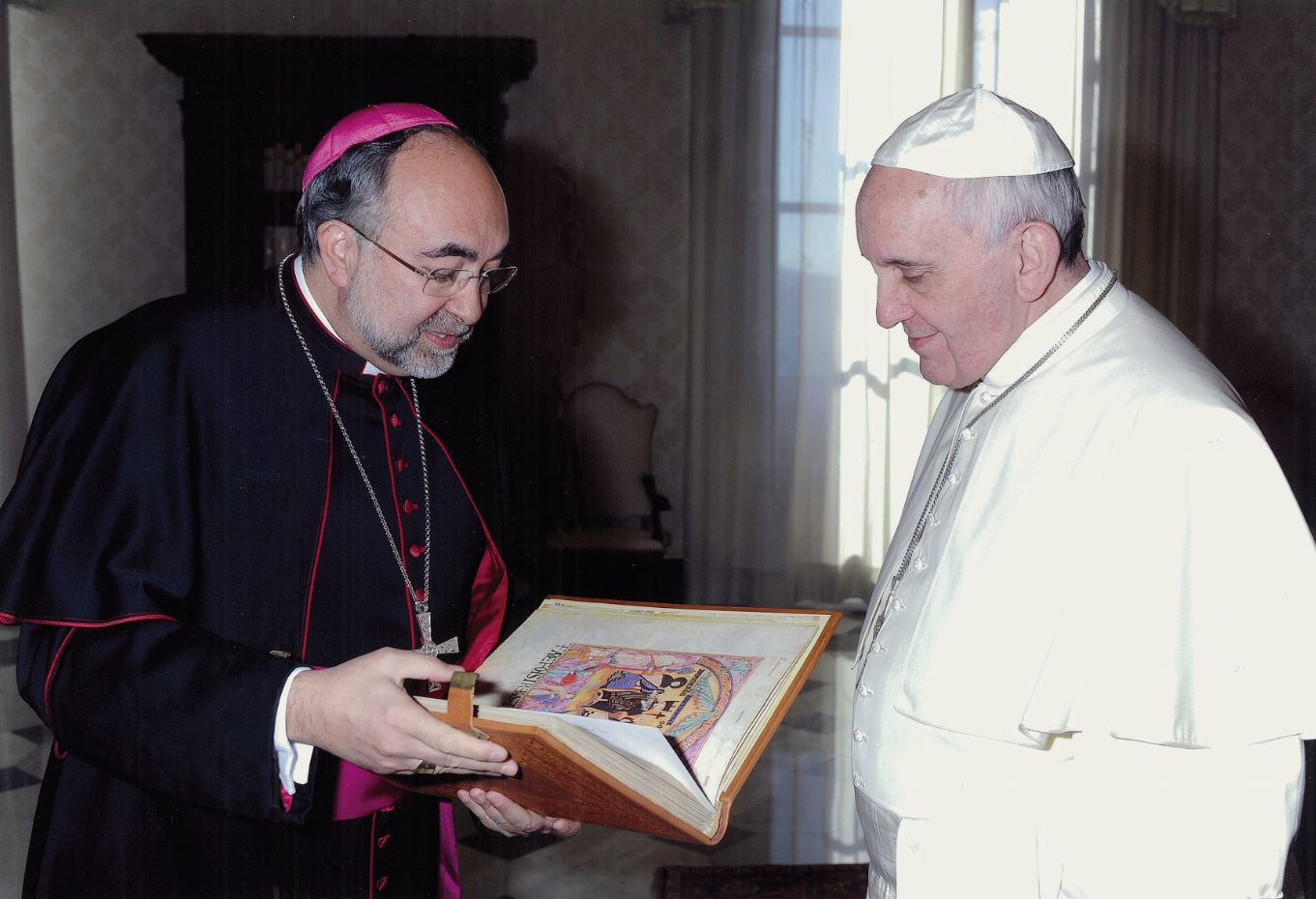 Pope Francis I with his Book of Testaments